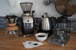Coffee, scales, brewers, green coffee beans and fresh roasted beans. The perfect cup of coffee